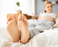 pregnant-woman-with-feet-up